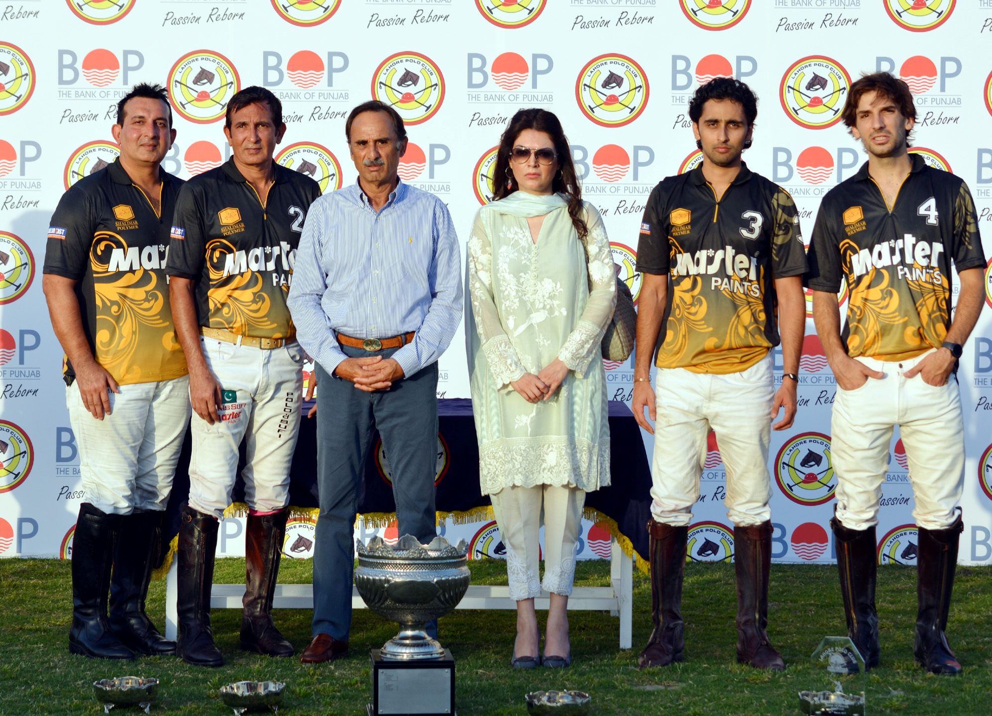 BoP Polo Cup Winning team Master Paints with the trophy