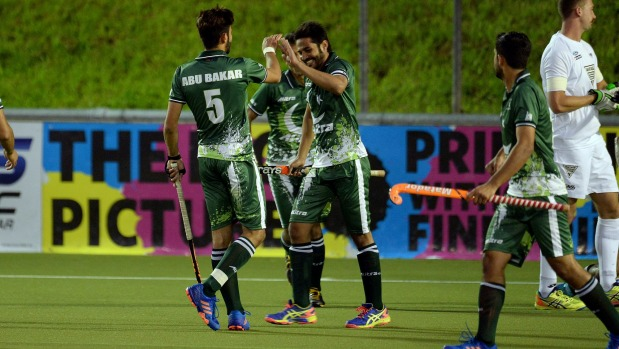 Pakistan's Abu Mahmood celebrates scoring one of his three goals against New Zealand